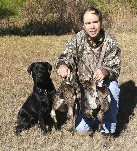 Black Lab loves retrieving ducks for his owner