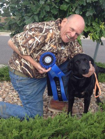 Hunter with black Labrador Retriever