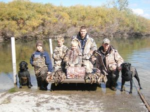 Successful duck hunt with two black Labs
