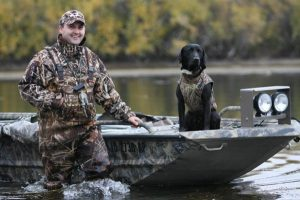 Hunter and black Lab get ready for hunting season