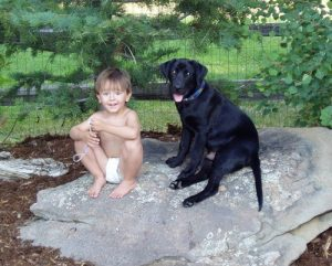 Black Lab puppy and his best friend