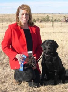 Showing off her dog show trophy and ribbons